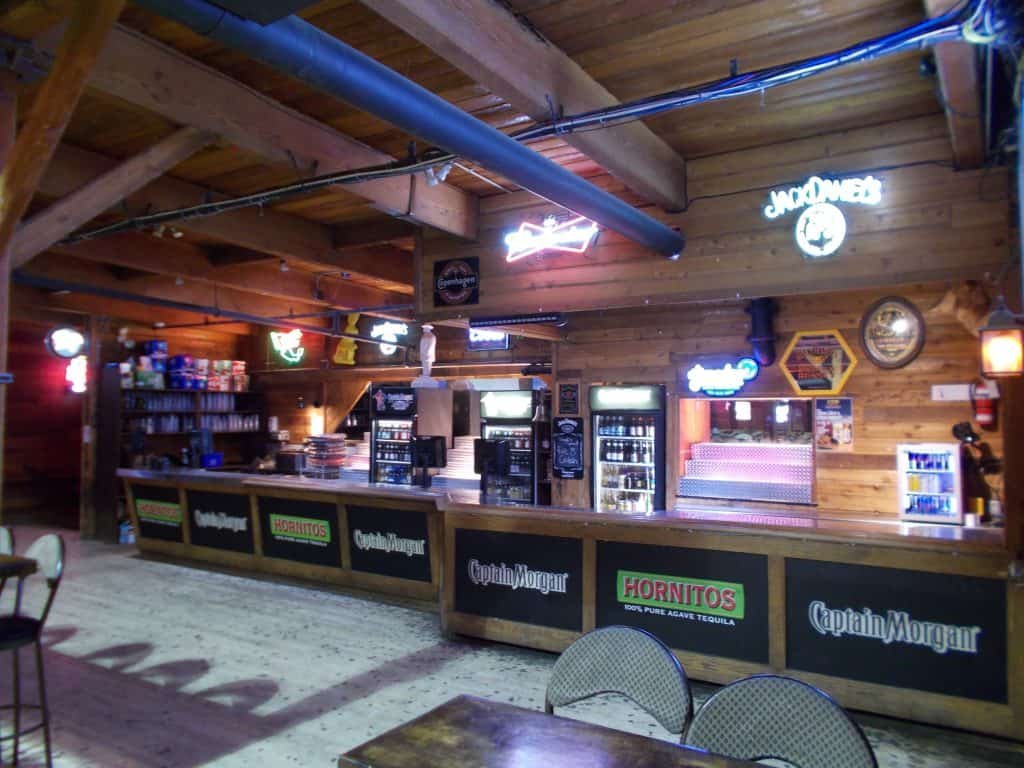 Close up of bar seating area at Cook County Saloon Edmonton